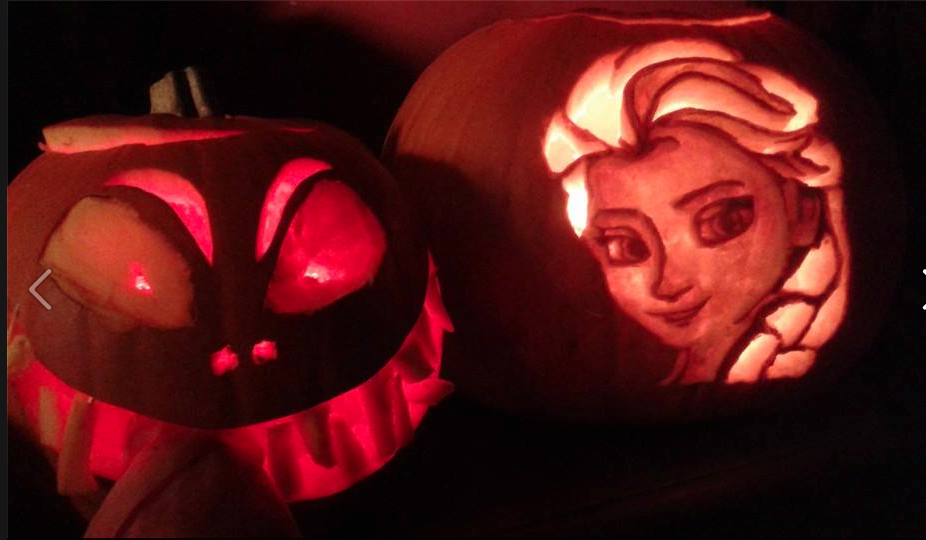Look who it is! My friend's teenage daughter carved Elsa from Frozen into her pumpkin. Amazing!